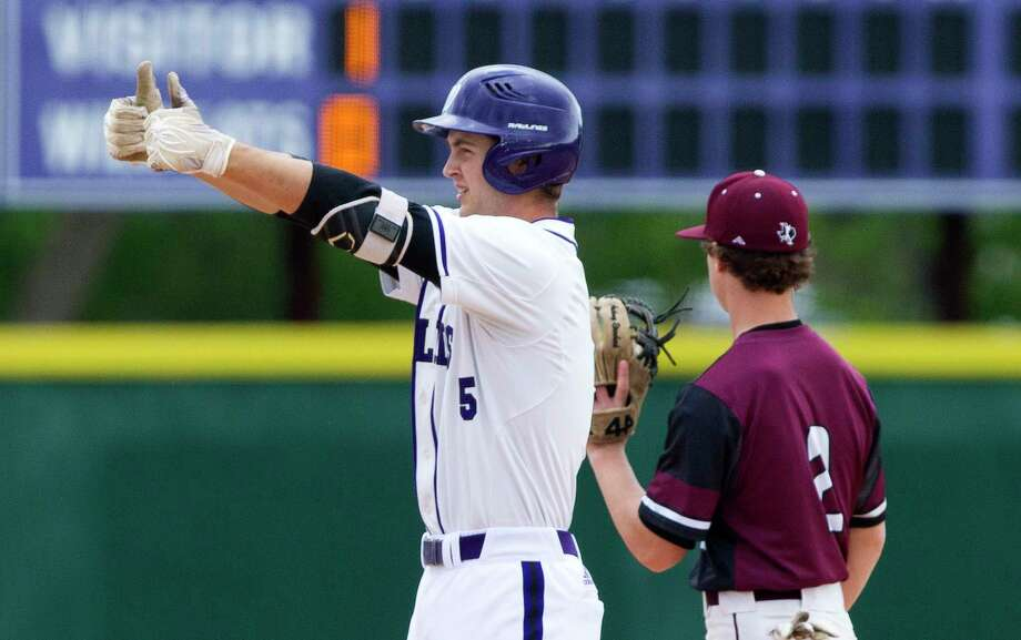 Willis' Jace Mapston gives a thumbs-up to the Wildkat dugout after hitting a double during the first inning of a District 20-5A high school baseball game, Tuesday, April 3, 2018, in Willis. Photo: Jason Fochtman, Staff Photographer / © 2018 Houston Chronicle