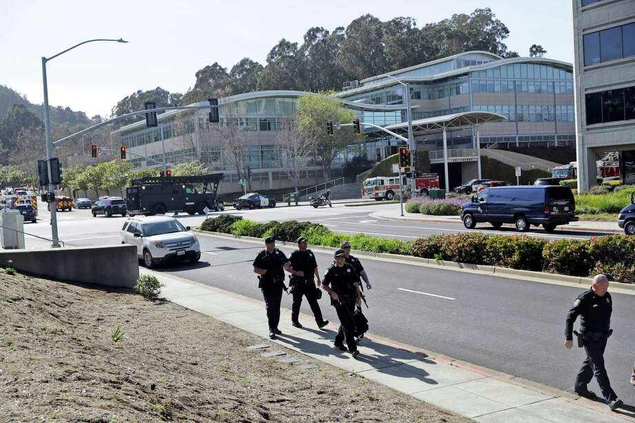 Armed law enforcement walk in front of YouTube headquarters, Tuesday, April 3, 2018, in San Bruno, Calif. A woman opened fire at YouTube headquarters Tuesday, setting off a panic among employees and wounding several people before fatally shooting herself, police and witnesses said.(AP Photo/Marcio Jose Sanchez) Photo: Marcio Jose Sanchez / Copyright 2018 The Associated Press. All rights reserved.