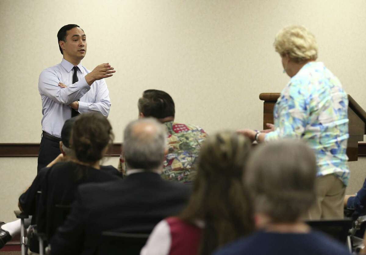 Democratic U.S. Rep. Joaquin Castro (left) holds a town hall for constituents Tuesday at his district office.
