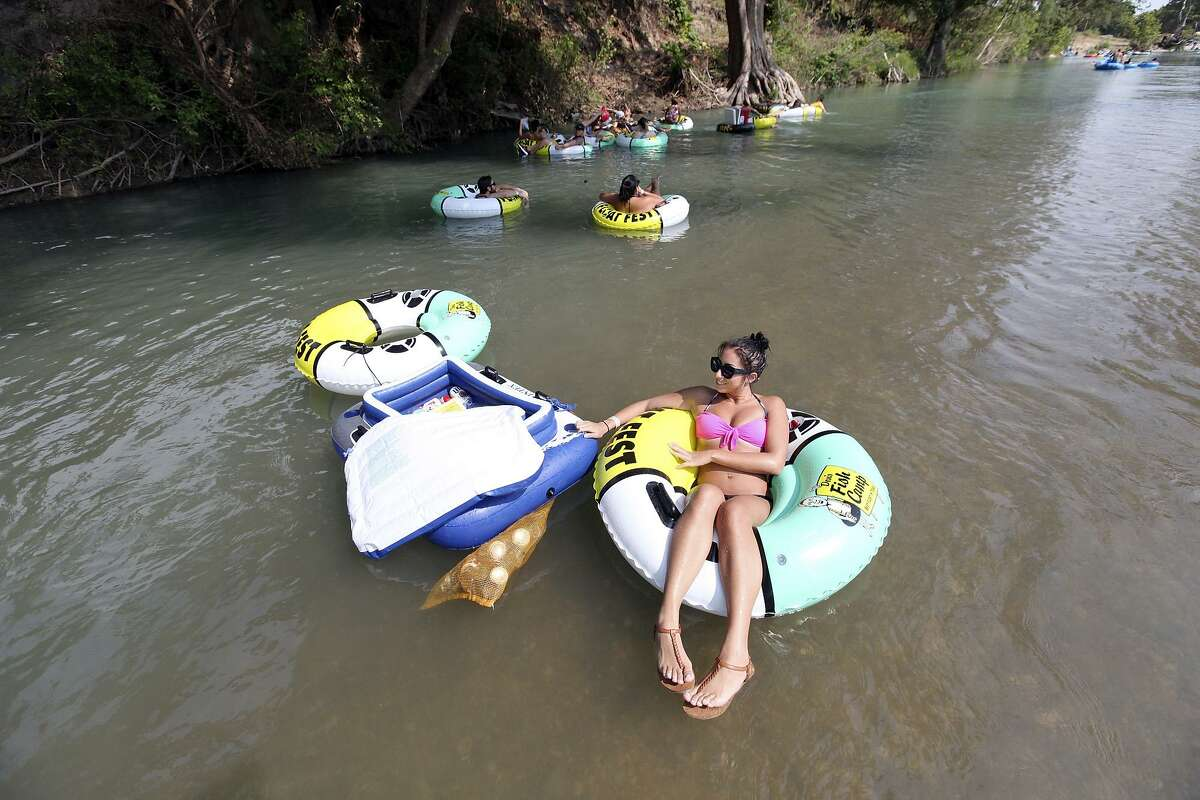 Tubers float the San Marcos River while attending Float Fest held at Cool River Ranch Sunday Aug. 30, 2015 in Martindale, Tx.