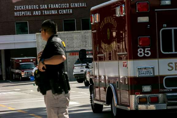 San Francisco Sheriff's official guards outside Zuckerberg General Hospital and Trauma Center, Tuesday, April 3, 2018, in San Francisco, Calif. Police responded to a report of an active shooter at YouTube headquarters in the city of San Bruno. Three of the victims have been transported to General Hospital.