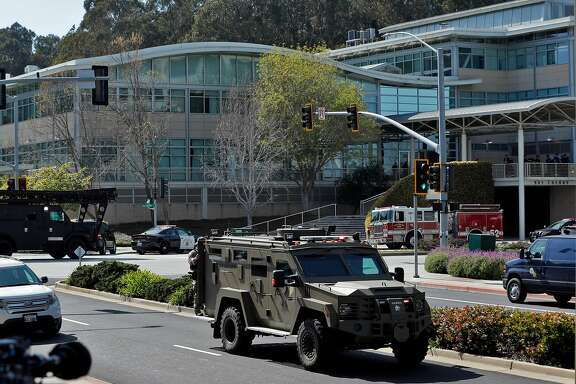 Police and emergency personnel surround the YouTube headquarters after a woman allegedly opened fire on several employees, including her boyfriend, before taking her own life in San Bruno, Calif., on Tuesday, April 3, 2018.