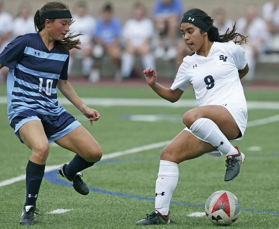 The Ranger's Gaby Valdez manuevers around Ashley Stamps as Smithson Valley plays Johnson in a boys and girls soccer double header at Farris Stadium on April 3, 2018. Photo: Tom Reel, Staff / San Antonio Express-News / 2017 415916Z.1 ANTONIO EXPRESS-NEWS