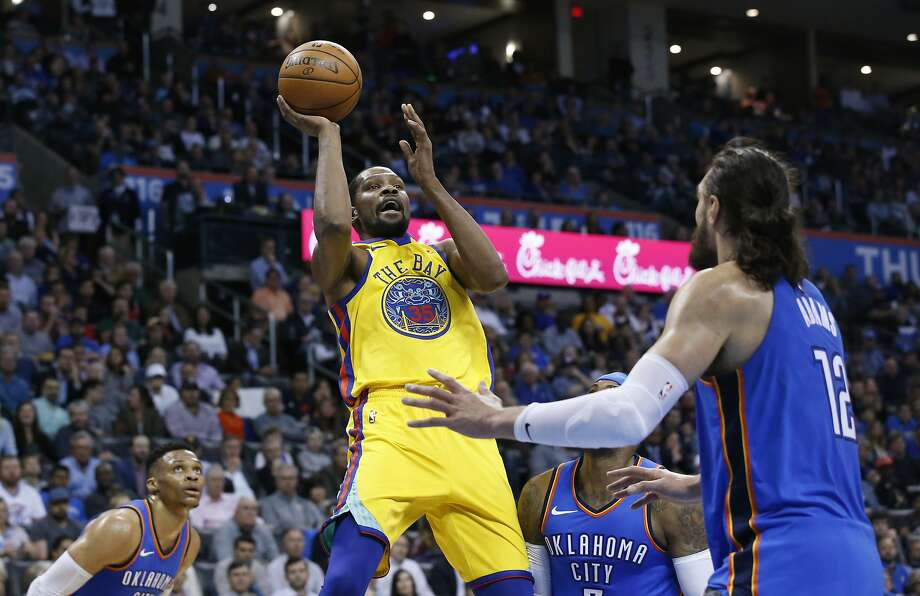 Golden State Warriors forward Kevin Durant (35) shoots between Oklahoma City Thunder guard Russell Westbrook, left, forward Carmelo Anthony, center, and center Steven Adams during the first half of an NBA basketball game in Oklahoma City, Tuesday, April 3, 2018. (AP Photo/Sue Ogrocki) Photo: Sue Ogrocki / Associated Press