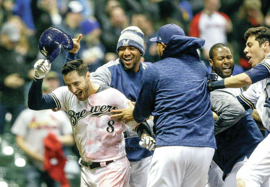 The Brewers' Ryan Braun is doused with Gatorade after his walk-off home run against Cardinals pitcher Dominic Leon in the bottom of the ninth inning Tuesday in Milwaukee. Photo: Tom Lynn | AP Photo