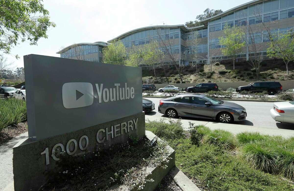 A YouTube sign is shown across the street from the company's offices in San Bruno, Calif., Tuesday, April 3, 2018. A woman opened fire at YouTube headquarters Tuesday, setting off a panic among employees and wounding at least four people before fatally shooting herself, police and witnesses said.