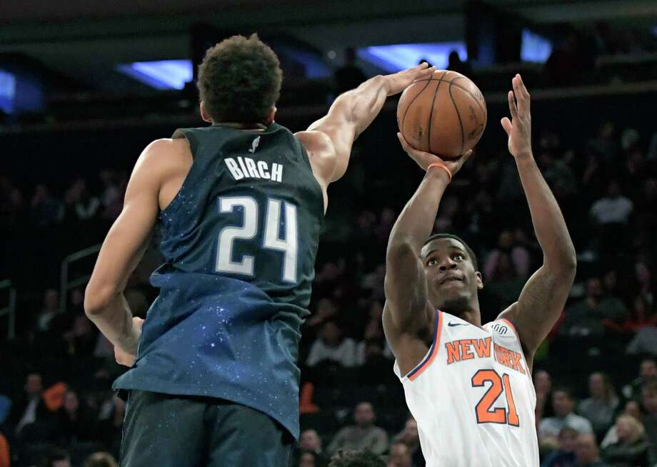 New York Knicks guard Damyean Dotson (21) attempts a shot as Orlando Magic center Khem Birch (24) goes for the block during the fourth quarter of an NBA basketball game Tuesday, April 3, 2018, at Madison Square Garden in New York. The Magic won 97-73. (AP Photo/Bill Kostroun) Photo: Bill Kostroun / FR51951 AP