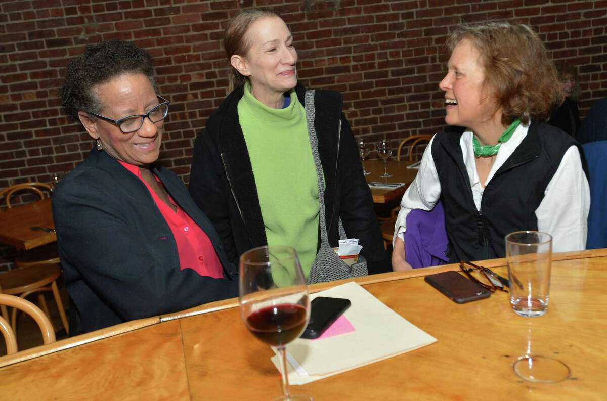 Daine Jellerette, Diane Lauricella and Lynn Massey talk and go over their readings at the Norwalk Public Library's Fifth Annual Lit Crawl at Fat Cat Pie Co. on Tuesday in Norwalk.