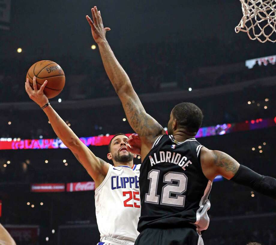 San Antonio Spurs forward LaMarcus Aldridge (12) blocks the shot attempt of Los Angeles Clippers guard Austin Rivers (25) during the first half of an NBA basketball game in Los Angeles on Tuesday, April 3, 2018. (AP Photo/Reed Saxon) Photo: Reed Saxon, Associated Press / Copyright 2018 The Associated Press. All rights reserved. This material may not be published, broadcast, rewritten or redistribu