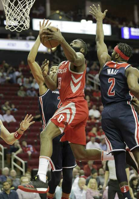 Houston Rockets guard James Harden (13) splits Washington Wizards defense as he drives to the basket in the first half of game action at the Toyota Center on Tuesday, April 3, 2018, in Houston. ( Elizabeth Conley / Houston Chronicle ) Photo: Elizabeth Conley, Chornicle / Houston Chronicle / © 2018 Houston Chronicle