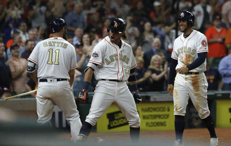 Josh Reddick (center) cracked two homers Tuesday in the Astros' win, but arguably his biggest play came in the outfield Photo: Karen Warren, Staff / Houston Chronicle / © 2018 Houston Chronicle