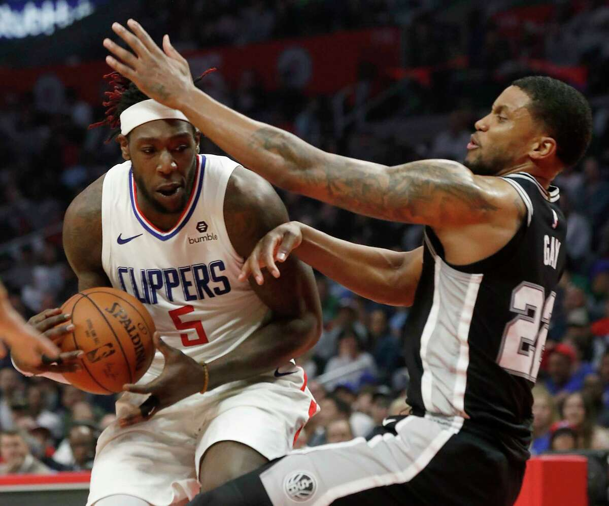 The Los Angeles Clippers' Monrezl Harrell (5) bulls his way to the basket against the San Antonio Spurs' Rudy Gay in the second quarter on Tuesday, Apr. 3, 2018, at Staples Center in Los Angeles.