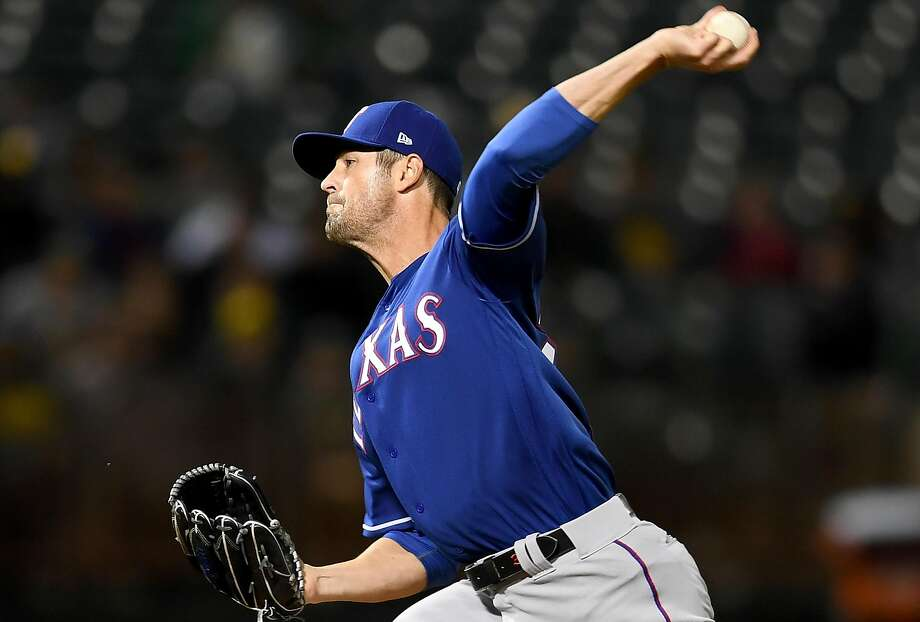 OAKLAND, CA - APRIL 03:  Cole Hamels #35 of the Texas Rangers pitches against the Oakland Athletics in the bottom of the second inning at the Oakland Alameda Coliseum on April 3, 2018 in Oakland, California.  (Photo by Thearon W. Henderson/Getty Images) Photo: Thearon W. Henderson / Getty Images