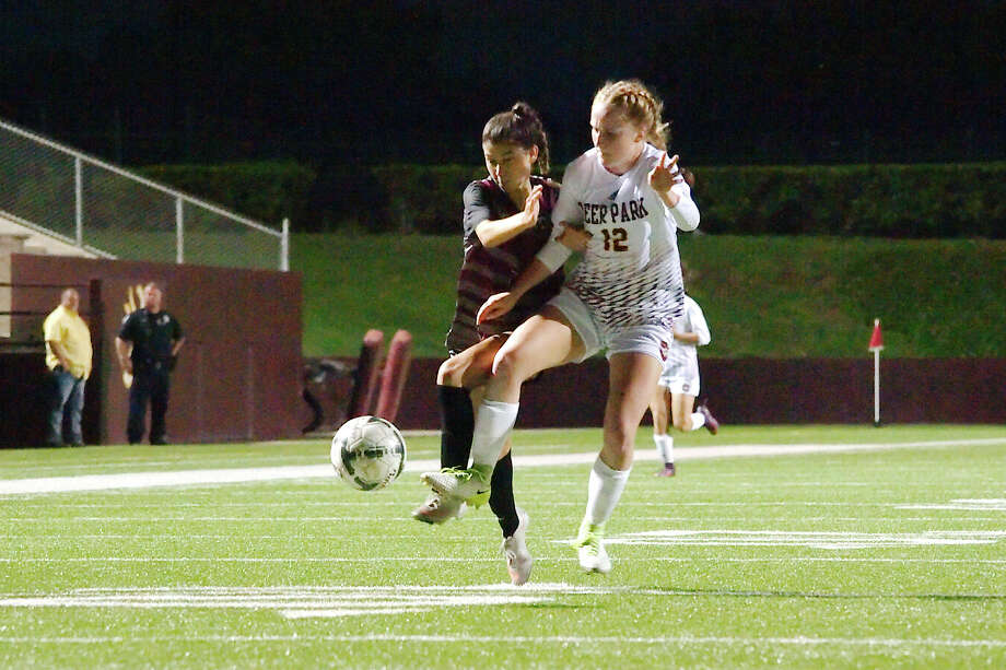 Pearland's Mckenzie Rizqi (2) and \Deer Park's Nyah Shepherd (12) fight for the ball Tuesday, Apr. 3 at Deer Park High School. Photo: Kirk Sides / © 2018 Kirk Sides / Houston Chronicle