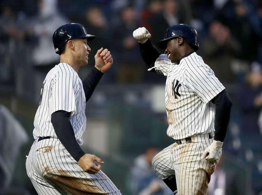 Aaron Judge (left) greets Yankees teammate Didi Gregorius after his three-run homer in the seventh. Photo: Elsa / Getty Images