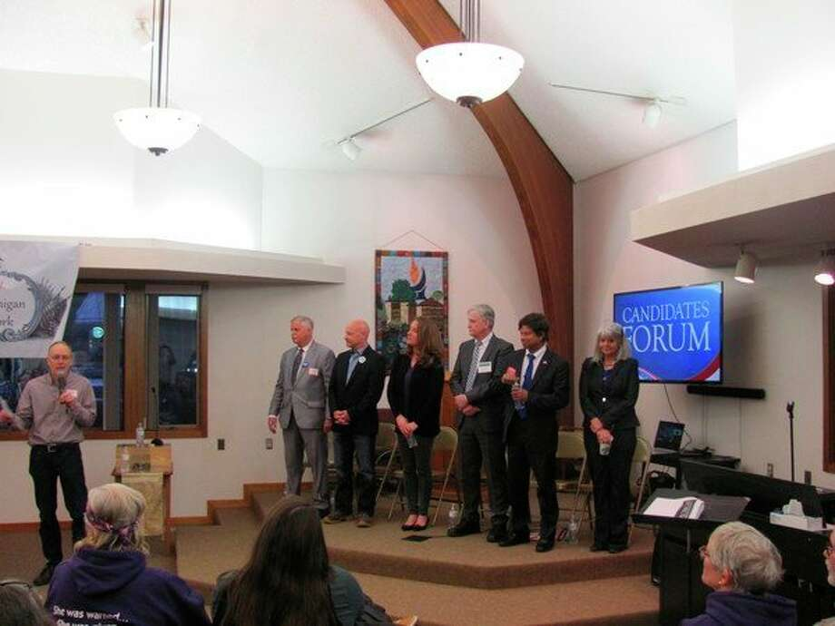 Democratic candidates attended the recent Women of Michigan Action Network Town Hall meeting. From left, emcee Joe Weir with microphone, Ziggy Kozicki, Dion Adams, Sarah Schulz, Jerry Hilliard, Shri Thanedar and Celia Young-Wenkel.