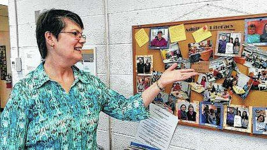 Pam Ritter points to photos of volunteers tutors and their students on a bulletin board in her office. About 200 people are now getting their chance to learn more about history and improve their literacy skills along the way through programs that volunteers with the Pekin YWCA offer at FCI Pekin, known informally as the Pekin federal prison, and at Tazewell County's jail. Photo: Michael Smothers | Pekin Times (AP)