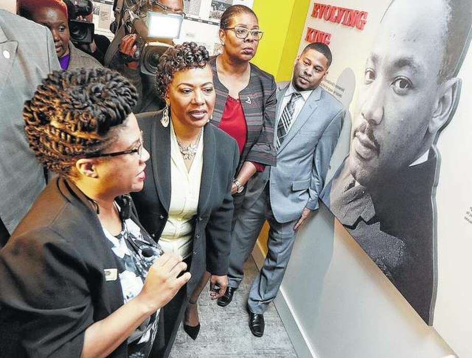 The Rev. Bernice King (second from left), daughter of the late civil rights leader the Rev. Dr. Martin Luther King Jr., tours an exhibit at the National Civil Rights Museum in Memphis, Tennessee. The museum formerly was the Lorraine Motel, where the elder King was assassinated April 4, 1968.
