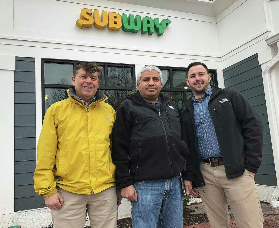 John Palumbo, director of construction for Subway; Ashwin Patel, franchise owner; and Chris Fraulo, business consultant for Subway, in front of the Fresh-Forward design Subway that will open later this month in Brookfield Village. Photo: Chris Bosak / Hearst Connecticut Media / The News-Times