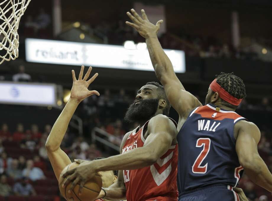 Houston Rockets guard James Harden (13) splits Washington Wizards defense as he drives to the basket in the first half of game action at the Toyota Center on Tuesday, April 3, 2018, in Houston. ( Elizabeth Conley / Houston Chronicle ) Photo: Elizabeth Conley/Houston Chronicle