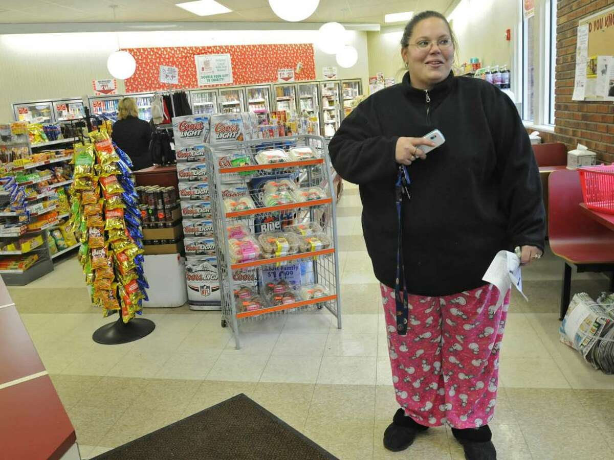 Tanya Macley, of Ballston Lake, shops for batteries in her Christmas pajamas in a Stewart's Shops store in Clifton Park on Friday. She says she needed batteries for gifts. (Lori Van Buren / Times Union)