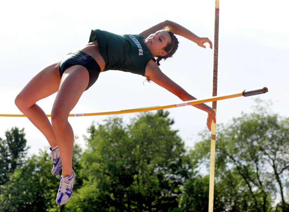 Shenendehowa's Shannon Lenzi shoves off the pole and clears a 9-foot vault during the Section II track meet. (Cindy Schultz / Times Union)