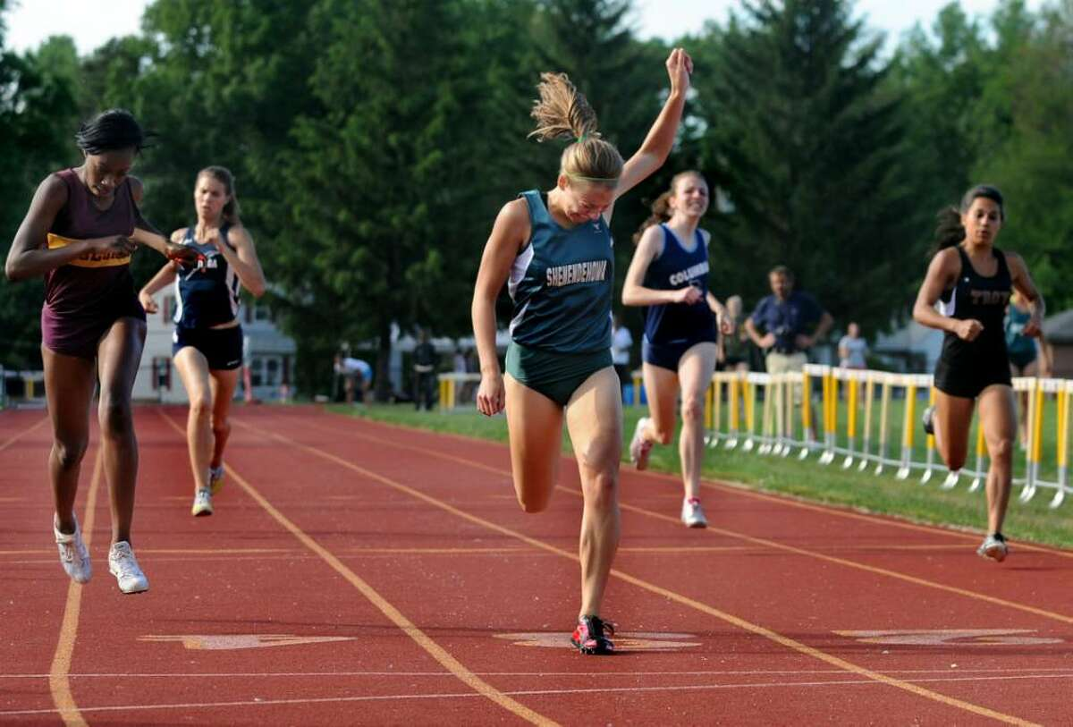 Shenendehowa's Kathleen Klein, right, wins the 400-meter run during the Section II track meet. (Cindy Schultz / Times Union)