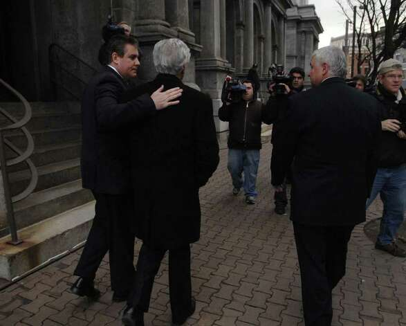 Ken Bruno, left, places his arm around his father, Ex-state senator, Joseph Bruno, as the two left the federal courthouse in Albany late Tuesday afternoon, Dec. 1, during jury deliberations in Bruno's trial on felony corruption charges. (Paul Buckowski / Times Union) Photo: PAUL BUCKOWSKI / 00006620A