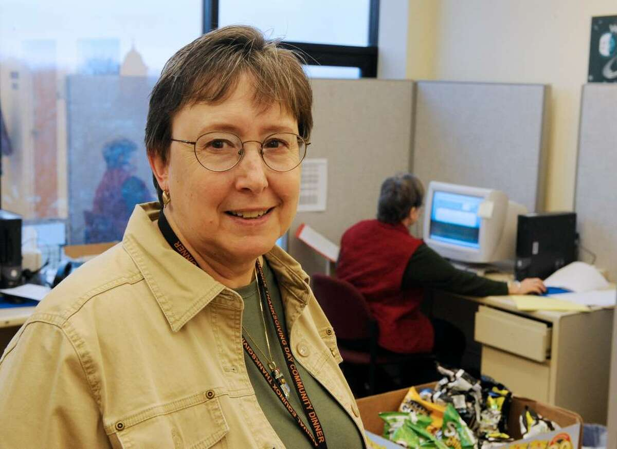 Nancy Virkler volunteers at the Equinox Call Center in Albany on Thanksgiving Day. She's been called the ultimate volunteer. (Skip Dickstein/Times Union)