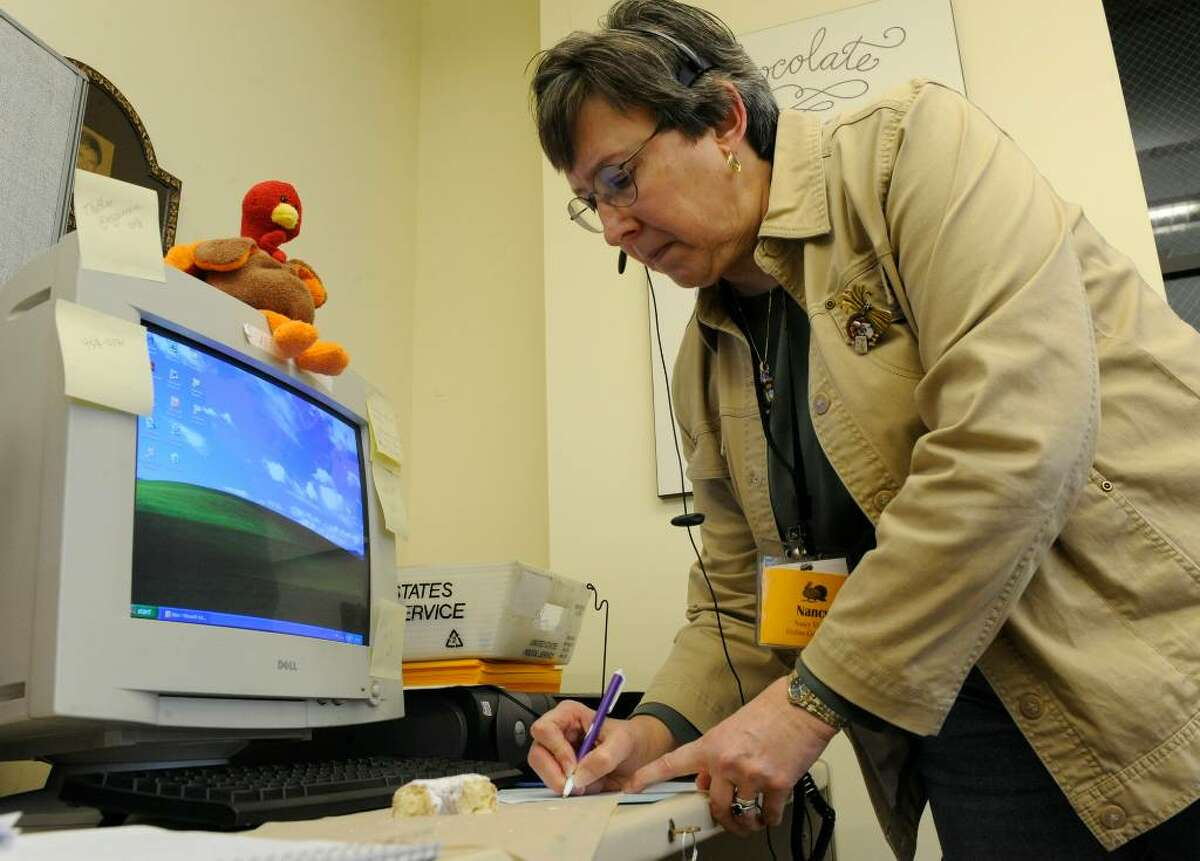 Nancy Virkler volunteers at the Equinox Call Center in Albany on Thanksgiving. (Skip Dickstein/Times Union)