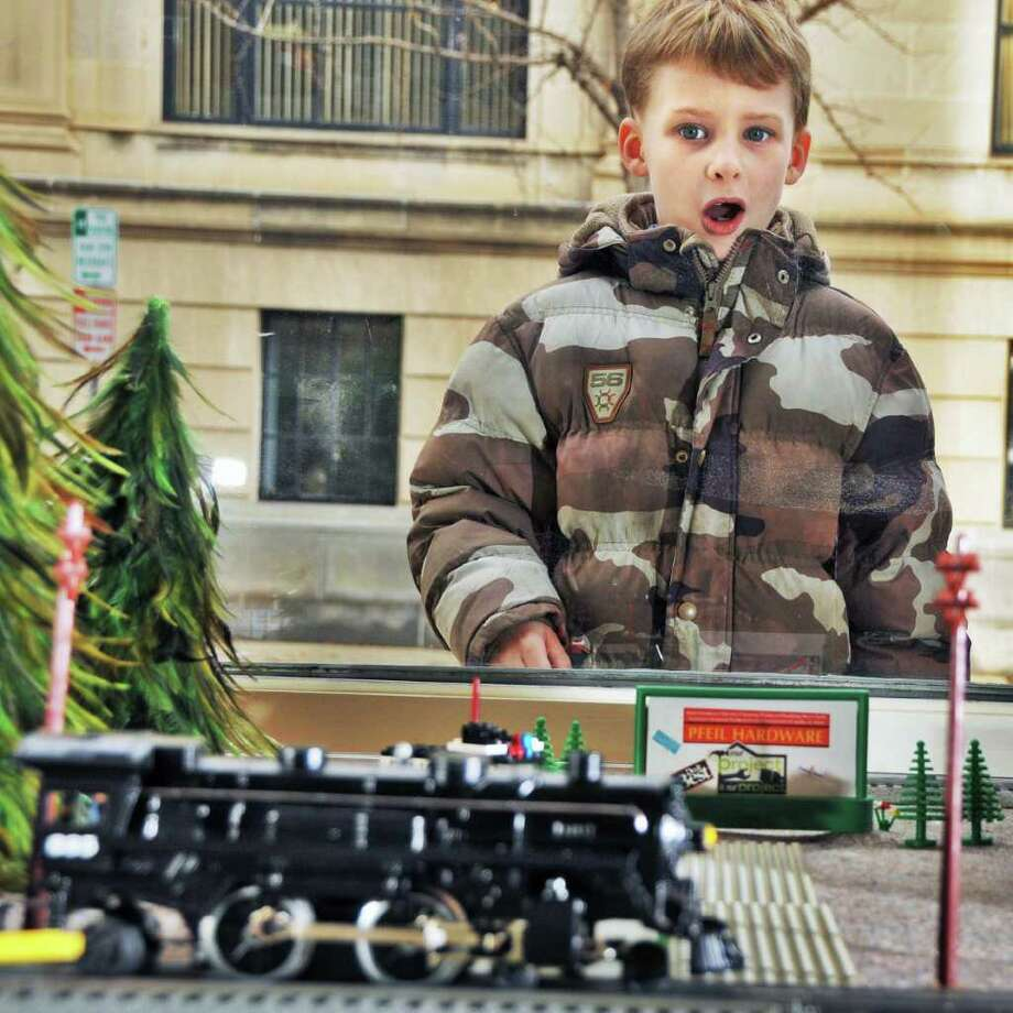 Seven-year-old James Haviland of Troy watches a toy train set up in the window of Pfeil Hardware in Troy, Wednesday November 25. This was Pfeil's first Christmas season in business.  (John Carl D'Annibale / Times Union) Photo: John Carl D'Annibale / 00006552A