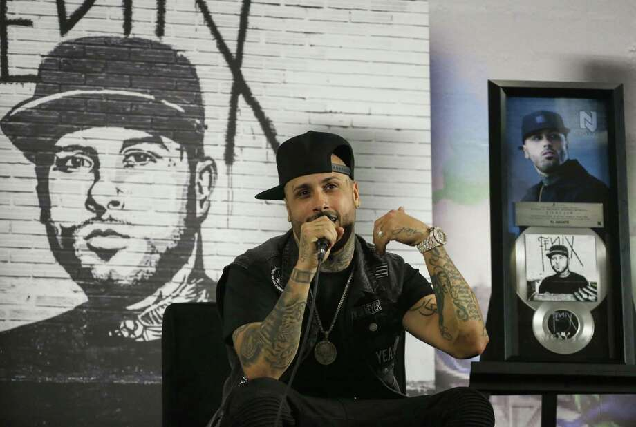 Reggaeton singer Nicky Jam performs Saturday at Smart Financial Centre at Sugar Land. Photo: Marco Ugarte, STF / Associated Press / Internal