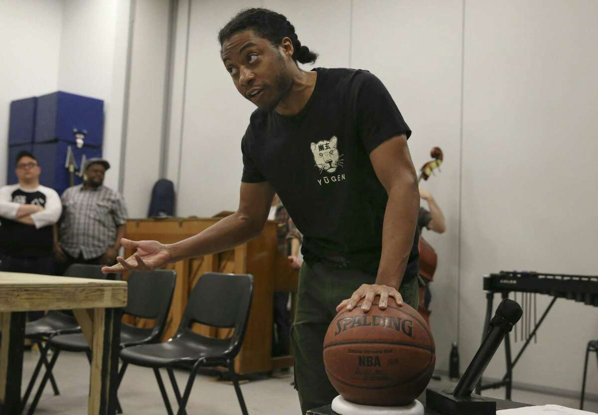 """The """"Small Ball"""" cast Orlanders Tao Jones, who plays Michael Jordan, performs during a rehearsal with the band at Midtown Arts and Theater Center Houston on Thursday, March 22, 2018, in Houston. The new musical is commissioned by Houston Rockets General Manager Daryl Morey."""