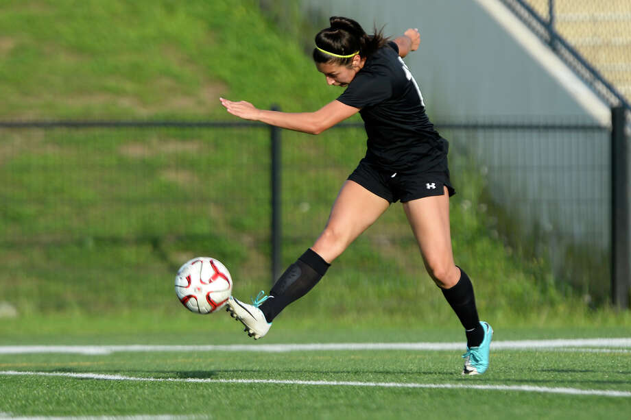 Jasper's Natalia Zavala takes a shot against Huffman in a girls soccer playoff game at the Thomas Center on Tuesday evening.  Photo taken Tuesday 4/3/18 Ryan Pelham/The Enterprise Photo: Ryan Pelham / ©2017 The Beaumont Enterprise/Ryan Pelham