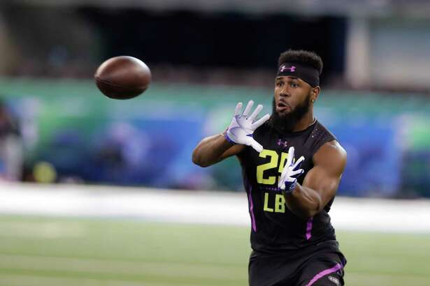 Clemson linebacker Dorian O'Daniel runs a drill during the NFL football scouting combine, Sunday, March 4, 2018, in Indianapolis. (AP Photo/Darron Cummings)