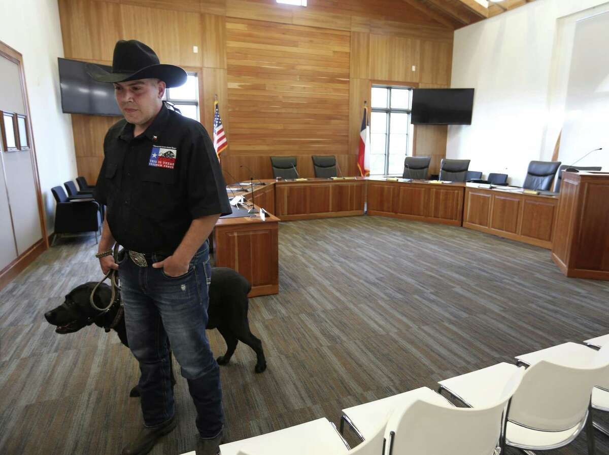 Brandon Burkhart of This is Texas Freedom Force talks to the media Wednesday, April 4, 2018 in the Alamo Heights city council chambers after the council voted to repeal a city gun ordinance that conflicted with Texas open carry laws.