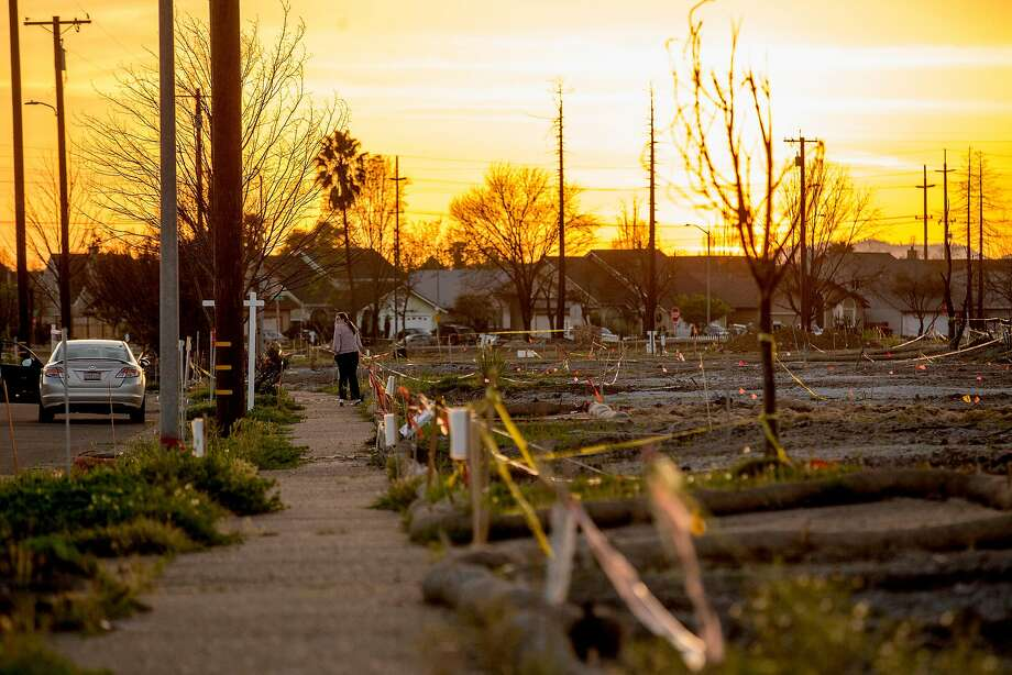 A woman takes a moment in the Coffey Park neighborhood, Wednesday, March 28, 2018, in Santa Rosa, Calif. The neighborhood was devastated by the Tubbs Fire. Photo: Santiago Mejia / The Chronicle