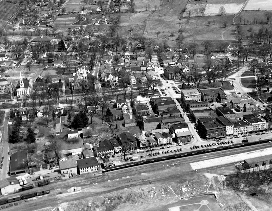 An aerial photograph taken in the 1930s shows the New Milford village center with Young's Field in the foreground and the slopes leading up to Second Hill to the top. Note large homes line the west side of the Village Green along Main Street all the way north to Bennitt Street. If you have a photograph you'd like to share, contact Deborah Rose at drose@newstimes.com or 860-355-7324. Photo: Courtesy Of Roger Szendy / The News-Times Contributed
