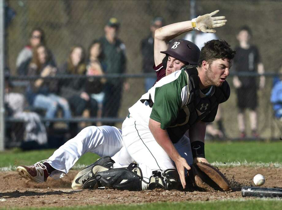 Bethel's Tyler Davis slides across home plate for a run while New Milford catcher Derek Profita waits for the throw last season in New Milford. Photo: H John Voorhees III / Hearst Connecticut Media File Photos / The News-Times