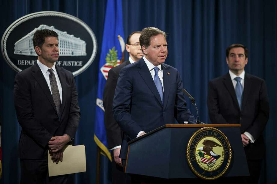 Geoffrey Berman, U.S. attorney for the Southern District of New York, center, speaks in March 2018 in Washington, D.C. Photo: Zach Gibson / Bloomberg / © 2018 Bloomberg Finance LP