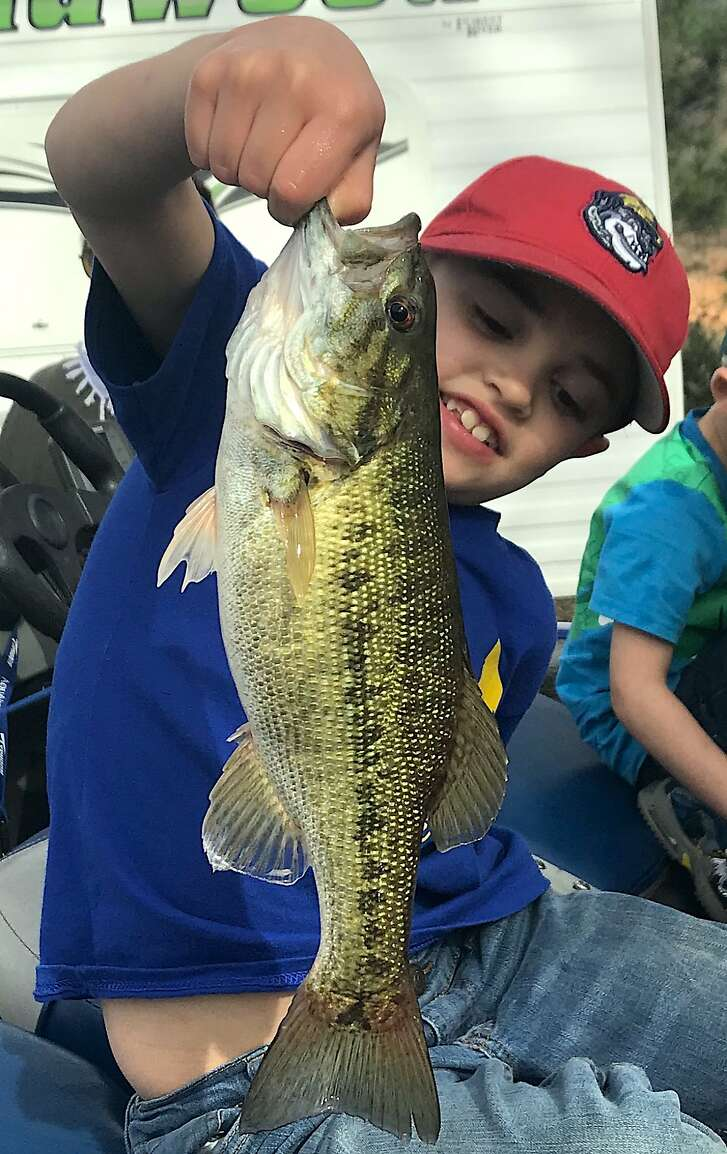 Instead of playing video games over spring, Oliver Solus, 7, went fishing with his parents, Heather and Wes Solus, and with his little Spiderman Fishing Rod, caught this nice bass at Shasta Lake