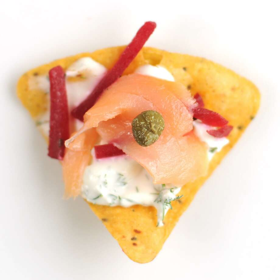 Russianacho topped with dilled cream cheese, pickled beet, smoked salmon and caper. Photo: Paul Stephen /San Antonio Express-News