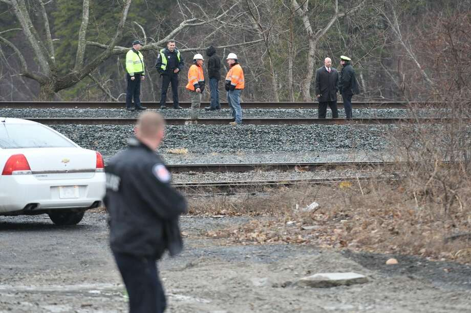 Police investigate the scene where a man was struck and killed by an Amtrak passenger train near Railroad Avenue at the Colonie town line on Wednesday, April 4, 2018. (Will Waldron/Times Union) Photo: Will Waldron/Times Union