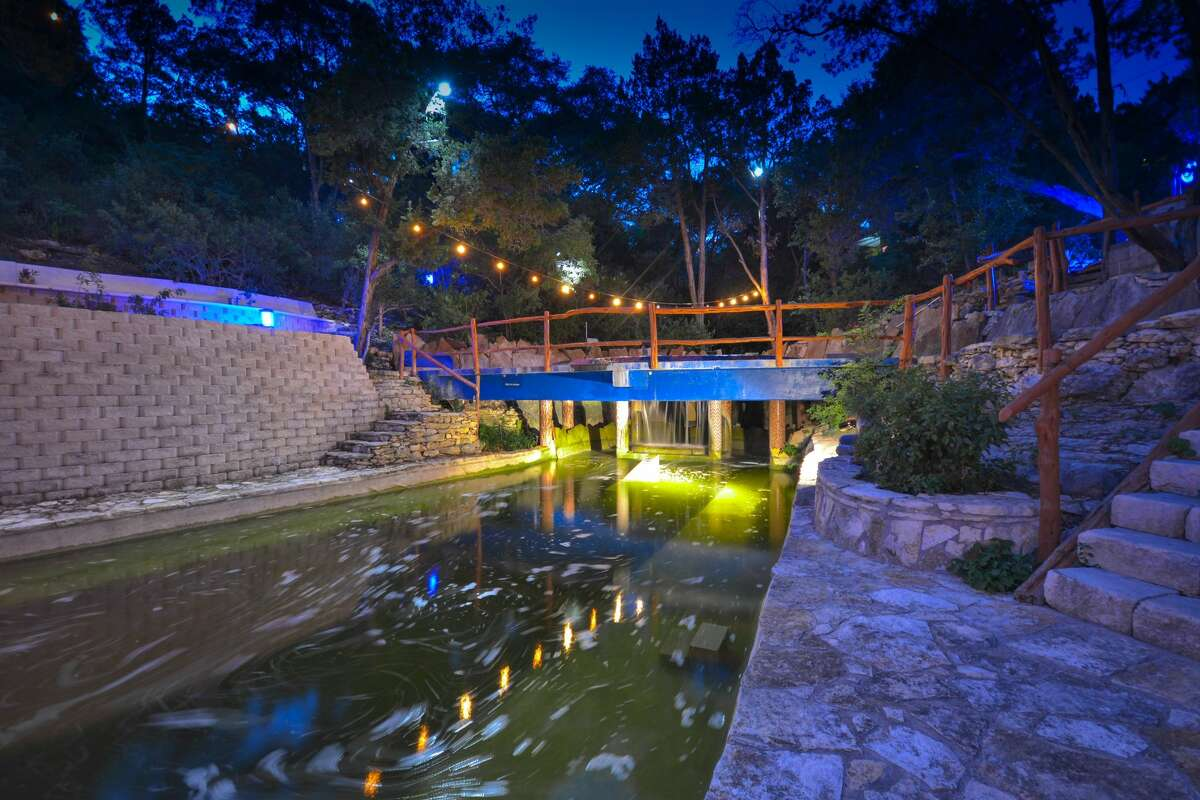 An estate for sale for $3.5 million at 1103 Ridgecrest Drive in Austin features an incredible natural pool in the backyard and it's like you have your own personal Barton Springs.