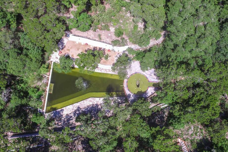 An estate for sale for $3.5 million at 1103 Ridgecrest Drive in Austin features an incredible natural pool in the backyard and it's like you have your own personal Barton Springs. Photo: Courtesy Of DMTX Realty
