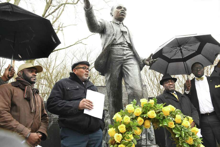 """Pastor Art Ware of Bethlehem, second from left, speaks as Capital Region members of the Alpha Phi Alpha Fraternity hold an """"Omega Service"""" commemorating the 50th anniversary of Martin Luther King Jr. assassination on National Day of Action at the Rev. Martin Luther King Statue  in Lincoln Park on Wednesday, April 5, 2018 in Albany, N.Y. (Lori Van Buren/Times Union) Photo: Lori Van Buren, Albany Times Union / 20043419A"""