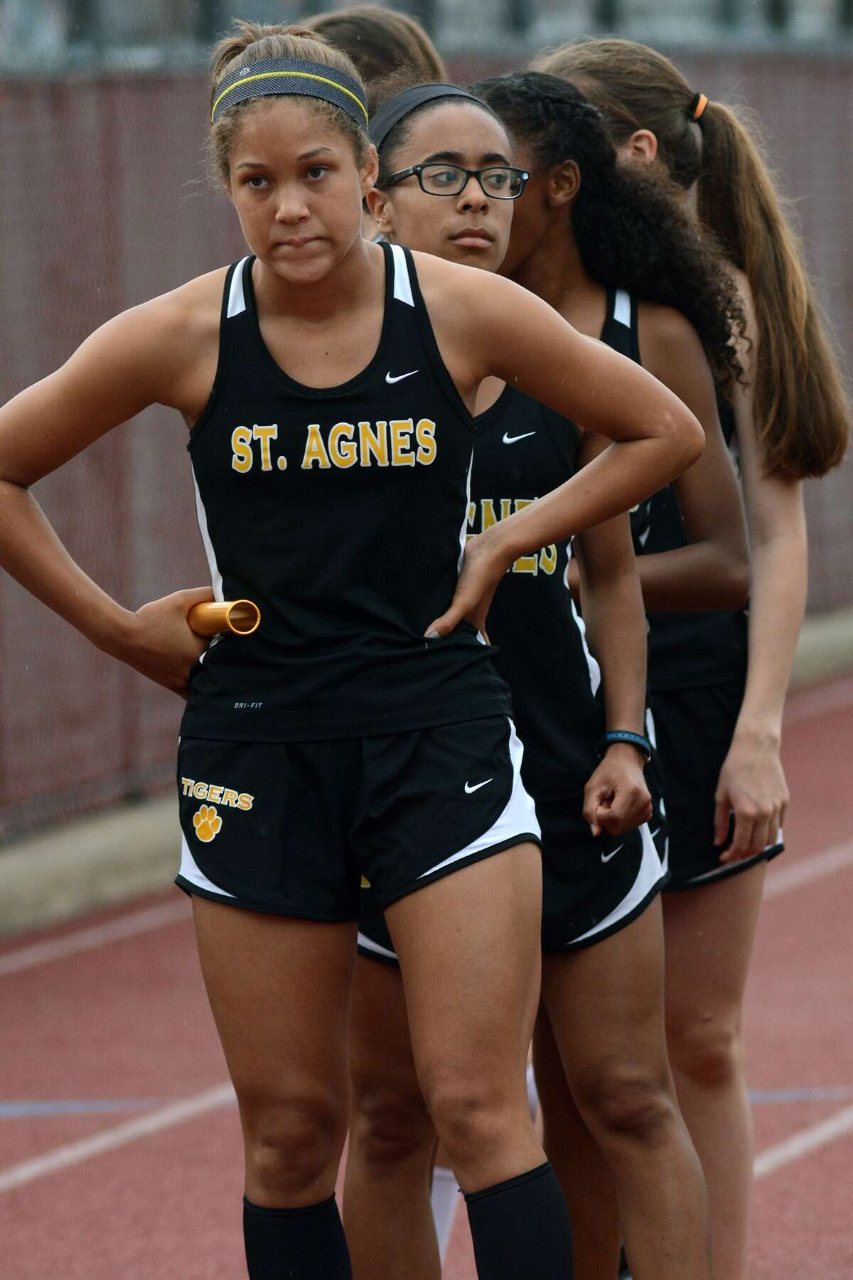 The St. Agnes Girls 4x400 Meter Relay team. including freshman Cristen Harrison, from left, sophomore Lauren Curran, sophomore Lauren Lowe, and freshman Meghan Rotter wait for the start of their event during the 2015 TAPPS 3-5A District Track Meet at St. Thomas High School on Wednesday, April 22, 2015.