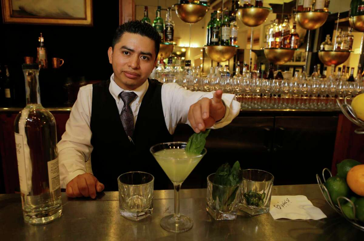 Bartender Adolfo Tzunun at Ouisie's Table, 3939 San Felipe, is shown Wednesday, March 28, 2018, in Houston.