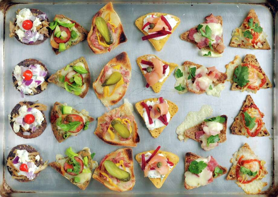 Assortment of nachos made with nontraditional chips and ingredients. Photo: Paul Stephen / San Antonio Express-News