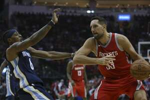 Houston Rockets forward Ryan Anderson (33) is called offense foul on Memphis Grizzlies guard Mario Chalmers (6) during the second quarter of an NBA game at Toyota Center on Saturday, Nov. 11, 2017, in Houston. ( Yi-Chin Lee / Houston Chronicle )